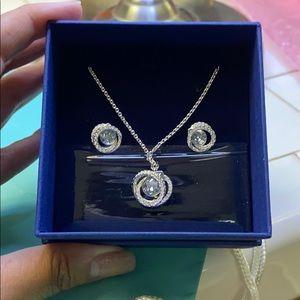 Brand new Swarovski necklace + matching earrings